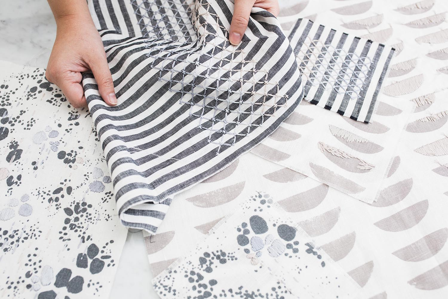 Rebecca Atwood + Sarah Laskow Collaboration - Hand Embroidered Pillows in Grays