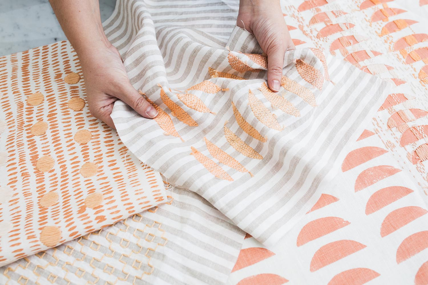 Rebecca Atwood + Sarah Laskow Collaboration - Hand Embroidered Pillows in Tangerine and Taupe