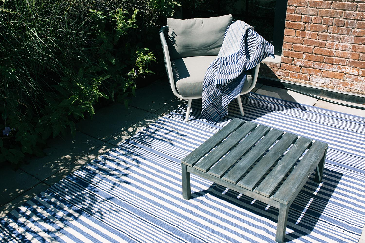 Rebecca Atwood Throw Blanket on Outdoor Patio