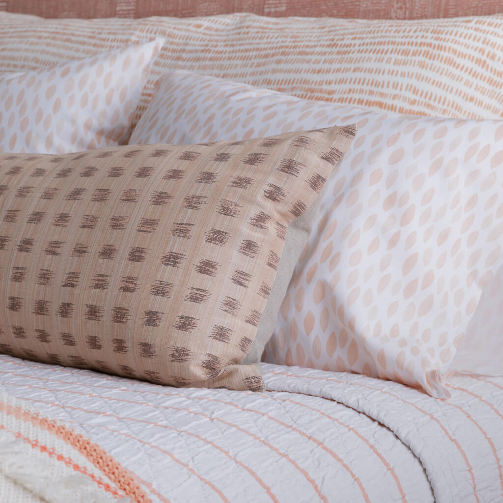 Gridded Ikat Lumbar Pillow in Peach/Pink