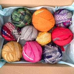 Box of mixed blanket offcut balls in the lucky dip pack