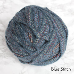 Ball of Blue teal and stitched thread 100% wool blanket yarn for rag rugs