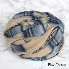 Ball of Blue and cream plaid or tartan colour 100% wool blanket yarn in striped pattern