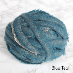 Ball of Blue teal colour 100% wool blanket yarn in plain striped pattern