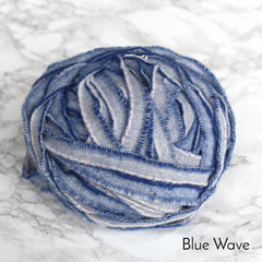 Ball of Blue wave colour 100% wool blanket yarn in striped pattern