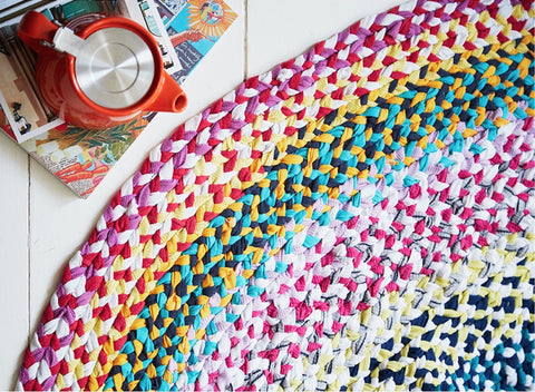 Handmade braided rag rug in rainbow colours