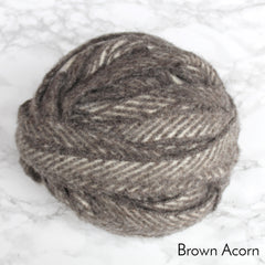 A light brown chevron ball of blanket yarn in a ball made of 100% wool