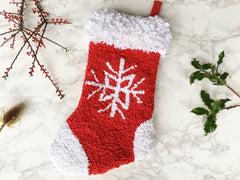 Festive handmade rag rug Christmas hanging stocking decoration in red and white with a snowflake pattern