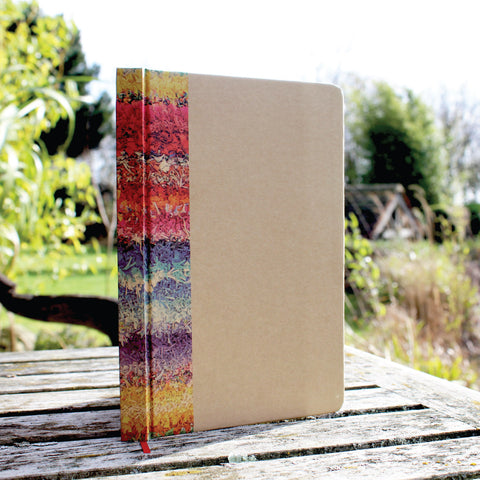 Ragged Life hardback notebook with brown cover and colourful rainbow rag rug image