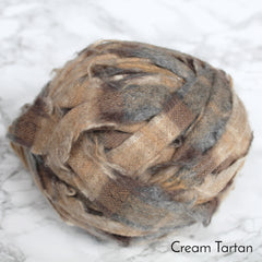 Cream, brown and grey checked soft blanket yarn in a ball to buy.