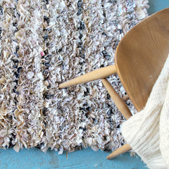Cream shaggy rag rug in proggy technique