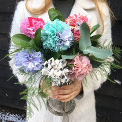 Rag rug flower bouquet in blue white pink and purple in a vase with greenery. Made using Ragged Life bouquet kit.