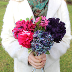 Rag rug flower bouquet in blue red pink and purple. Made using Ragged Life bouquet kit.
