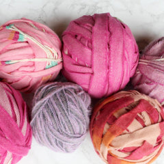 Ragged Life selection of pink balls of blanket yarn in different shades ready to be sold.