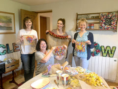 A happy group of four women showing off their work in progress rag rug pieces at a Ragged Life class