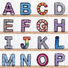 Personalised Ragged Life handmade colourful rag rug letters displayed on shelves as alphabet
