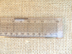 Hessian with a ruler to show the weave needed for rag rugging