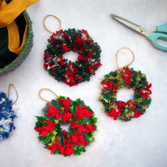 Three small rag rug wreaths with ties and scissors