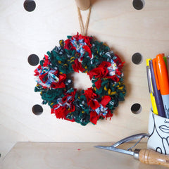 Mini rag rug xmas wreath on craft wooden peg board