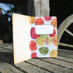 Ragged Life hardback notebook open with lined paper and a colourful shaggy polka dot rag rug image