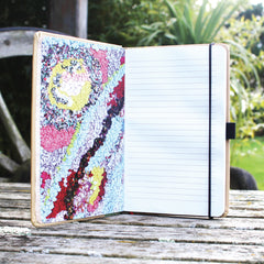 Ragged Life hardback notebook open with lined paper and a colourful loopy rag rug image