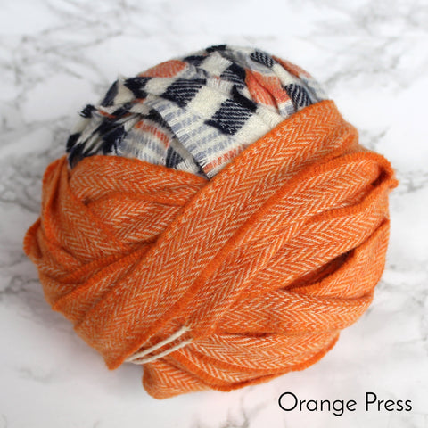 Orange, black and white ball of 100% wool blanket yarn for rag rugging