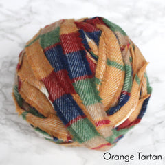 Ragged Life Rag Rug Blanket Yarn 100% Wool for Rag Rugging Crochet in Strips in brightly coloured orange, red, green and blue