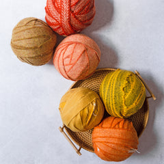 Orange and yellow balls of Ragged Life Blanket Yarn