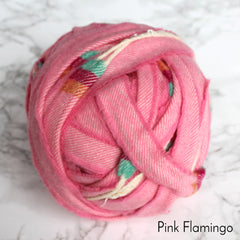 Bright pink, blue and orange 100% woollen blanket yarn wrapped into a ball or hank for sale.