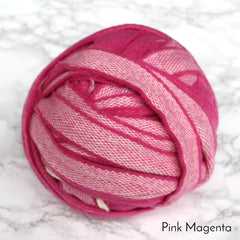 Bright pink magenta ball of 100% wool blanket yarn in strips for rag rugging