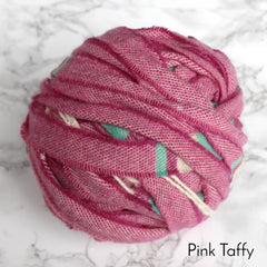 Deep pink coloured ball of woollen blanket yarn for rag rug making.
