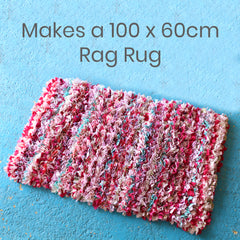 Pink striped rag rug made using old clothing and textile waste