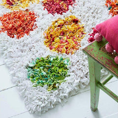 White spotty shaggy rag rug in children's bedroom