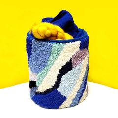 Blue and cream abstract rag rug container