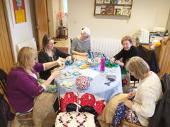 A rag rug class in progress with women hessian and fabric at a Ragged Life workshop