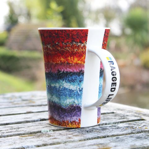 Ragged Life large mug with a rainbow stripe shaggy rag rug image