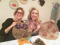 Two ladies making rag rug wreaths with hessian and rags at a Ragged Life workshop