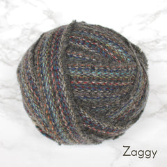 Ragged Life Rag Rug Blanket Yarn 100% Wool for Rag Rugging Crochet in Strips in Zaggy Grey with Multicoloured Stitching
