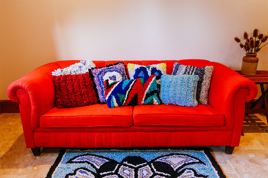 We love snuggling up with our rag rug cushions