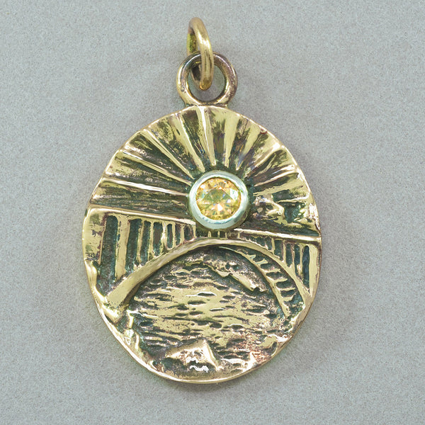 Jim Kelly 38th Anniversary Bronze and Champagne CZ Pendant