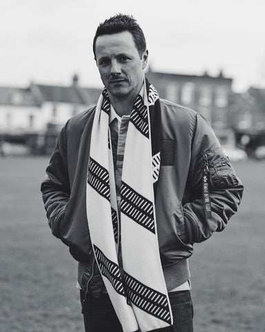 Darren Skey wearing the Corinthian men's Club Scarf