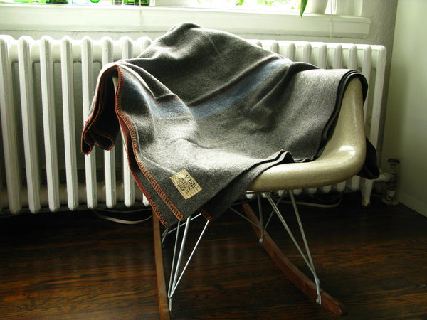 vintage blanket on vintage chair.