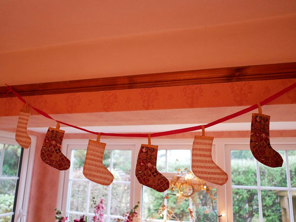 bunting style Christmas decoration with hanging stockings