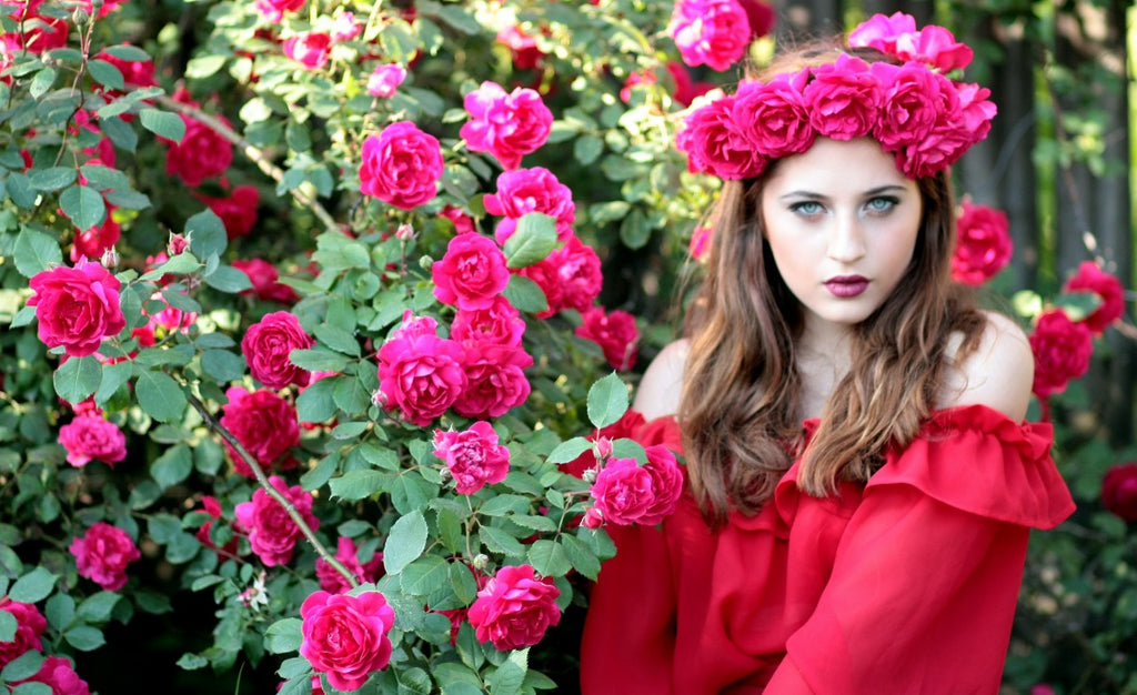 model-in-red-top-and-pink-roses