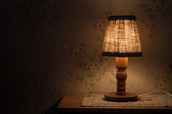 lamp on table in dark room