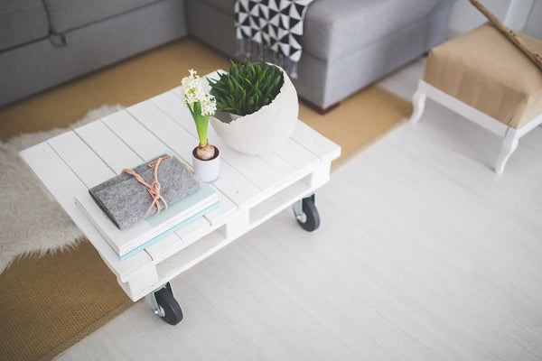 Coffee table with notepad in Scandinavian decor style