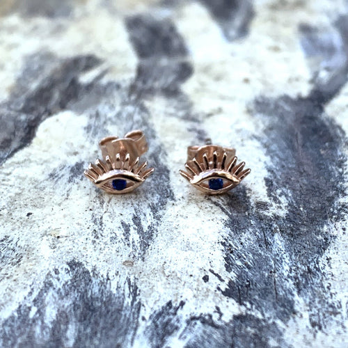 Sterling Silver Evil Eye Studs with lashes. 18k rose gold plated, blue cubic zirconia