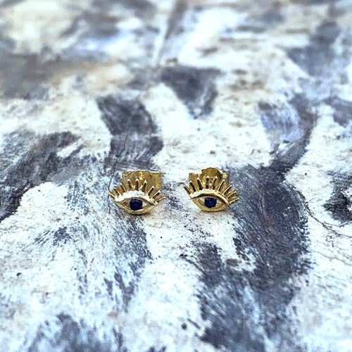 Sterling Silver Evil Eye Studs with lashes. 18k yellow gold plated, blue cubic zirconia