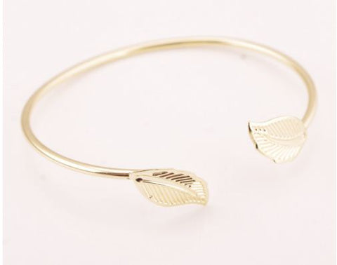 Teen Agers Yellow gold flexi tube bangle with leaf motif.