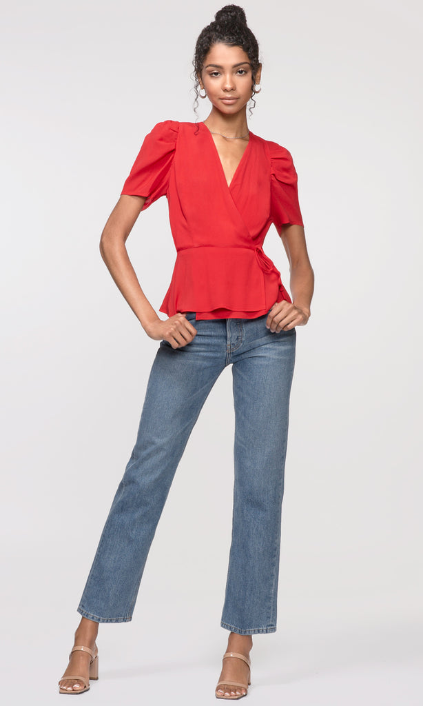 red wrap over pouf sleeve shirt